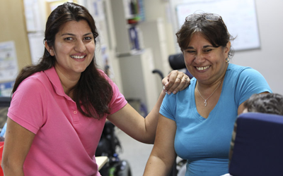 Photo of two Support Workers smiling
